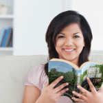 Woman reading there's no place like summer camp book