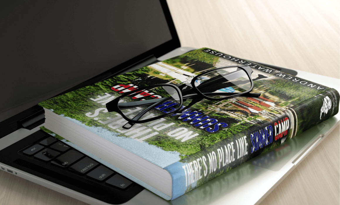 book on laptop with glasses